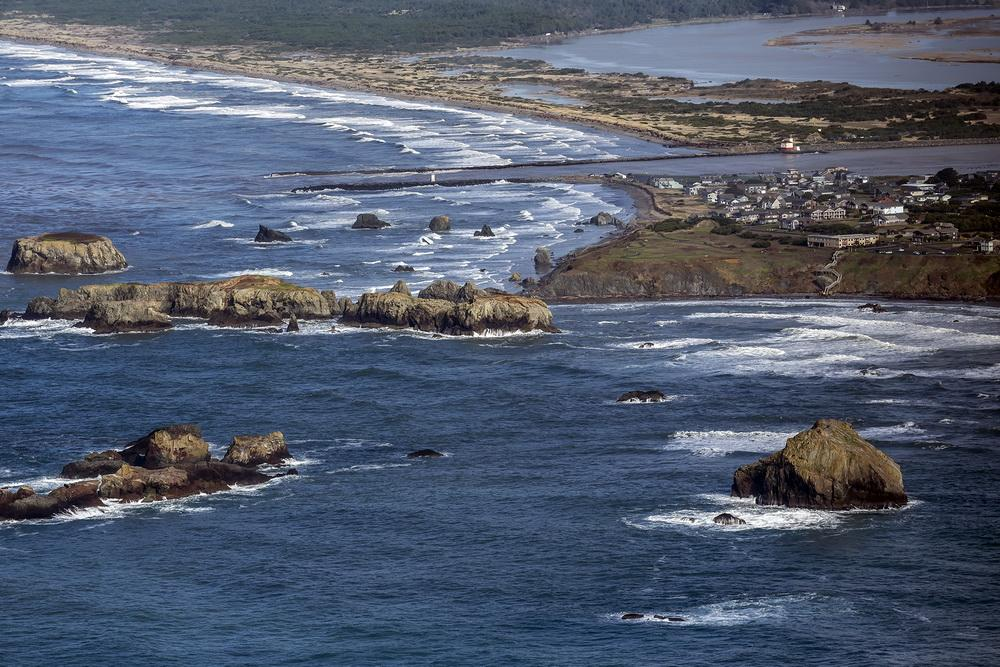 Coquille Point, with the mouth of the Coquille River in the background, from the air.\Photo by Rena Olson.
